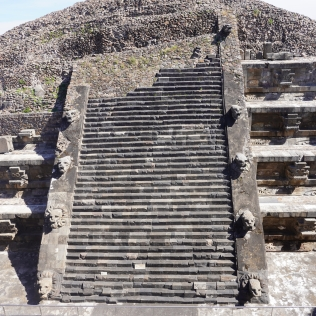 Detail of the pyramid, showing the alternating Tlaloc (left) and feathered serpent (right) heads.