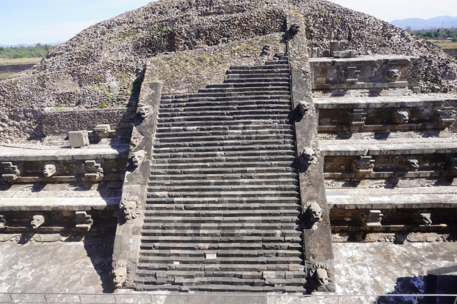 "Detail of the pyramid, showing the alternating ""Tlaloc"" (left) and feathered serpent (right) heads."