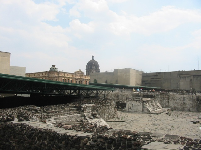 View of Eagle building and building A in the Templo Mayor complex. The ruins of the Great Temple are in the background.