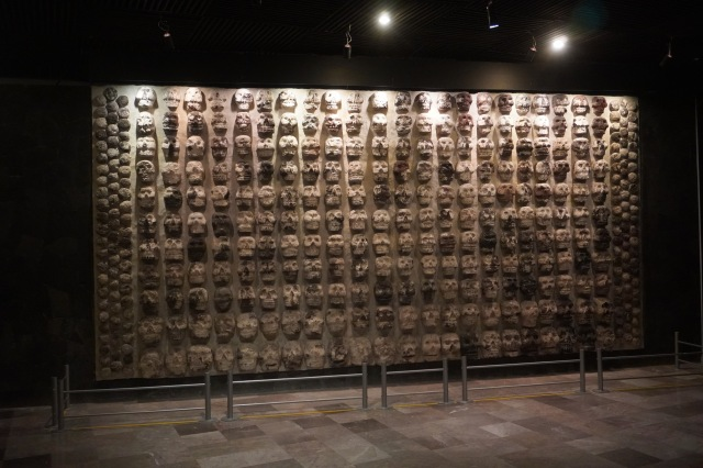 Wall display of stone masks found at the Templo Mayor site