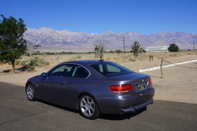 BMW with Visitor Center in Background